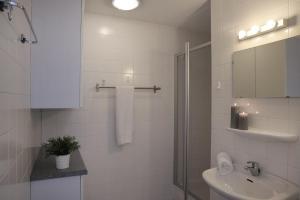 Een badkamer bij Appartementen Amelander Paradijs