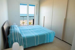 A bed or beds in a room at La Casa del Sido