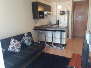 Una cocina o zona de cocina en Central Apartment Santiago BYP