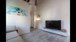 TV o dispositivi per l'intrattenimento presso casa a 800 metros de la playa de Las Arenas
