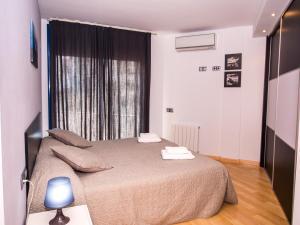 A bed or beds in a room at Sealand Sitges Apartments