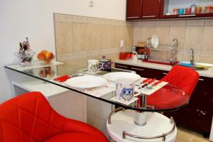 A kitchen or kitchenette at Stella Apartments