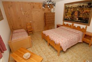 Un ou plusieurs lits dans un hébergement de l'établissement Baita Guana