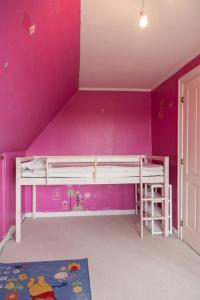 A bunk bed or bunk beds in a room at viby alle