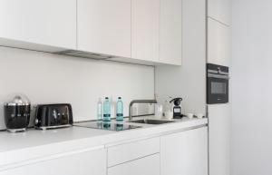A kitchen or kitchenette at Pure Salt Residences