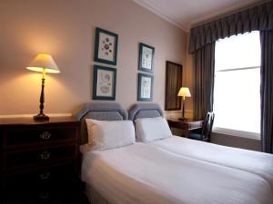 A bed or beds in a room at Skene House Hotels - Holburn