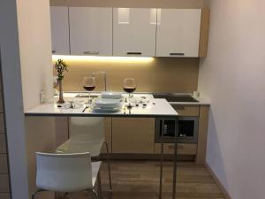 A kitchen or kitchenette at Boutique House Mim-A