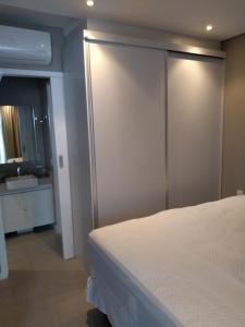 Cama ou camas em um quarto em Estacofor Santos - Apto 1304/1105