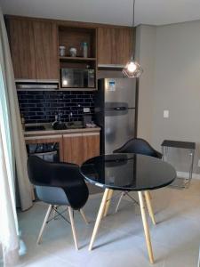 A cozinha ou cozinha compacta de Estacofor Santos - Apto 1304/1105