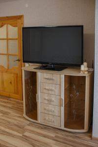 A television and/or entertainment center at Karjala Home on Pervomaysky