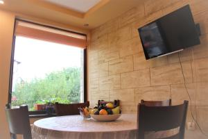 A television and/or entertainment centre at Rupchini Houses