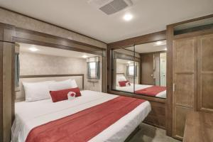 A bed or beds in a room at Sunshine Key King Travel Trailer 6