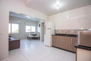 Una cocina o zona de cocina en Residencial Sol de Verão