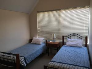 A bed or beds in a room at Ocean View Port Geographe
