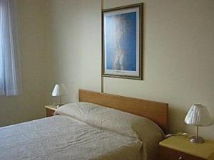 Cama o camas de una habitación en Residencial Solar Bela Vista