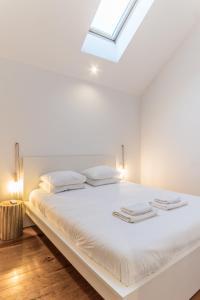 Cama ou camas em um quarto em LX 77