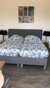 A bed or beds in a room at Apartment Hoornweg