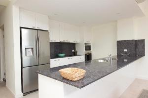 A kitchen or kitchenette at Regatta 14 / 142 Little Street