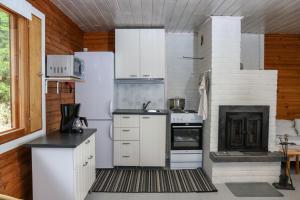 Küche/Küchenzeile in der Unterkunft Mertala