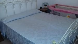 A bed or beds in a room at Casa Maria