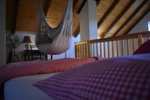 Ein Bett oder Betten in einem Zimmer der Unterkunft Kraut & Ruabn - Stadl