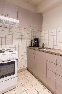 A kitchen or kitchenette at Delice Hotel - Family Apartments