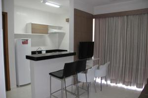A kitchen or kitchenette at Flat209 Veredas Rio Quente Particular