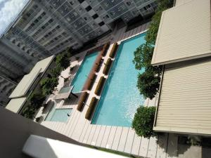 A view of the pool at 1br with balcony and wifi or nearby