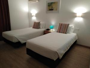 A bed or beds in a room at Estoril 7