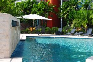 The swimming pool at or near at Peninsula Airlie Beach