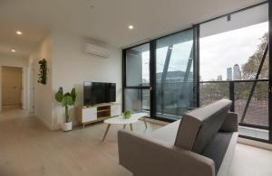 A seating area at Brand new apt at the heart of South Melbourne