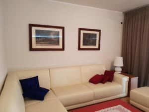 A seating area at appartamento melotti - palazzo sky
