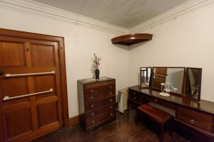 A television and/or entertainment center at Knockderry Castle apartment