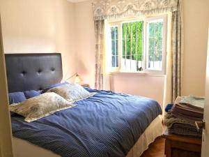 Una cama o camas en una habitación de Chalet en zona Güemes