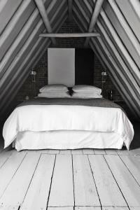 Een bed of bedden in een kamer bij NRDRHVN91