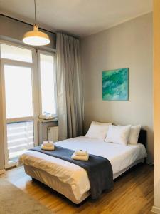 Cama o camas de una habitación en Concordia Apartments