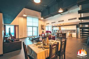 A restaurant or other place to eat at A C Pearl Holiday Homes - The Loft with Burj Khalifa View