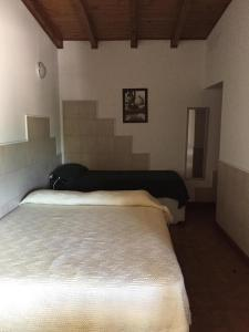 Una cama o camas en una habitación de Departamentos Camilo