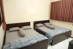 A bed or beds in a room at Villa Cemara
