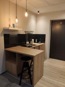 A cozinha ou kitchenette de H33 Apartamenty