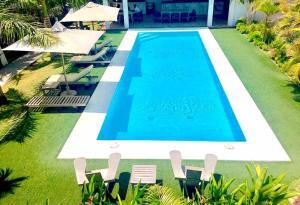 Uitzicht op het zwembad bij Pedasí Ocean Properties of in de buurt