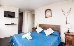 Cama o camas de una habitación en Zenteno Apartments