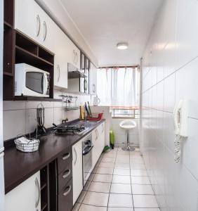 Una cocina o zona de cocina en Zenteno Apartments