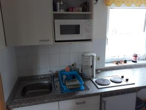 A kitchen or kitchenette at Ostseeperle