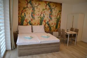 Postel nebo postele na pokoji v ubytování Slope Apartments Lipno