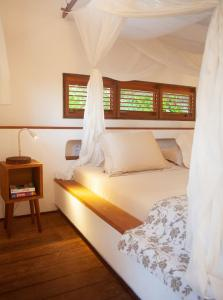 A bed or beds in a room at La Ferme De Georges