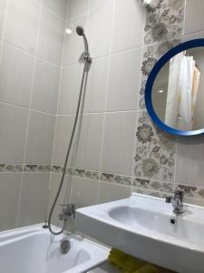 Ванная комната в Центральные Апартаменты