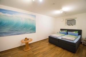 Ein Bett oder Betten in einem Zimmer der Unterkunft Anton's Souterrain-Wohnung