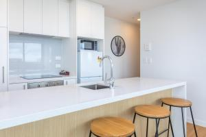 A kitchen or kitchenette at Star Queens Serviced Apartments