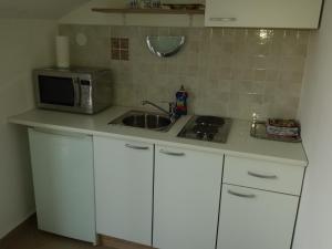 Kuchyň nebo kuchyňský kout v ubytování Apartment Star